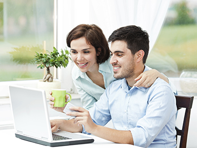 a couple looking at laptop screen